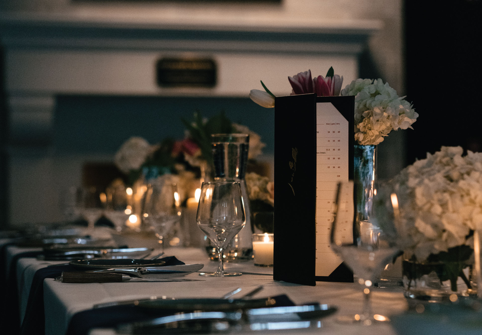Dinner table with Cutlery and a Wine menu